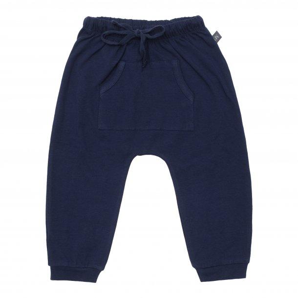 Navy baggy bukser med lomme - Little Wonders